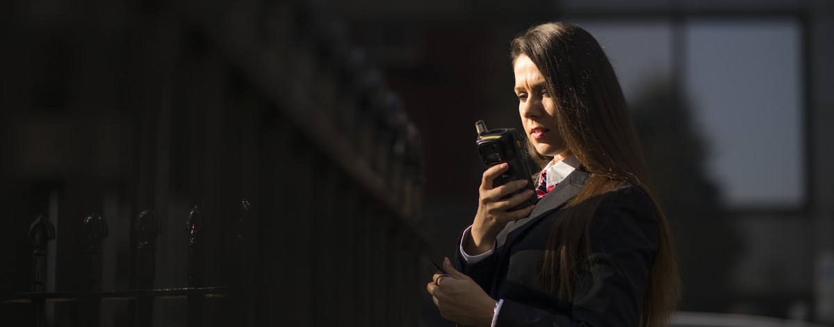 G4S officer holding mobile device