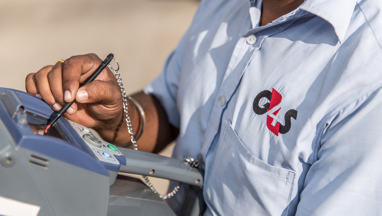 G4S Security Guard inputting information into a digital console