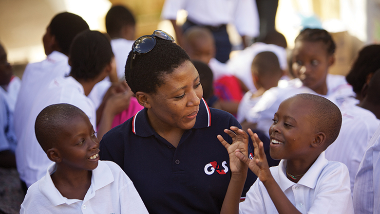 G4S Barbados employee with children