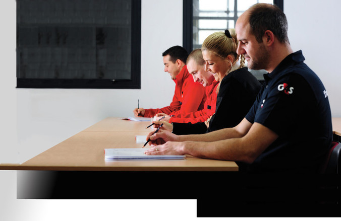 People at desk in training course