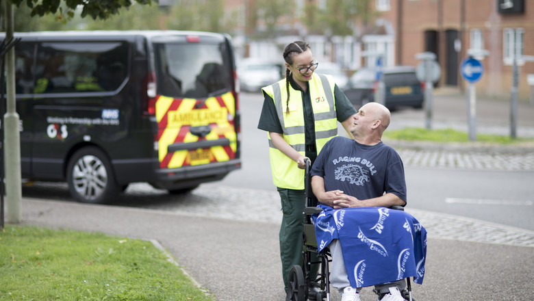 Patient Transport Service worker with patient