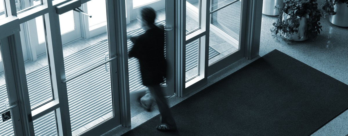 Surveillance shot of man exiting a building