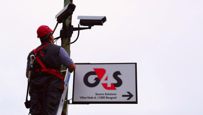 G4S employee installing security systems