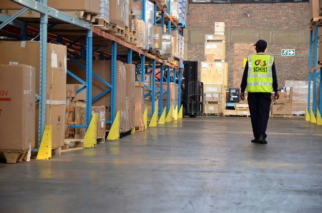 Security Officer patrolling in warehouse