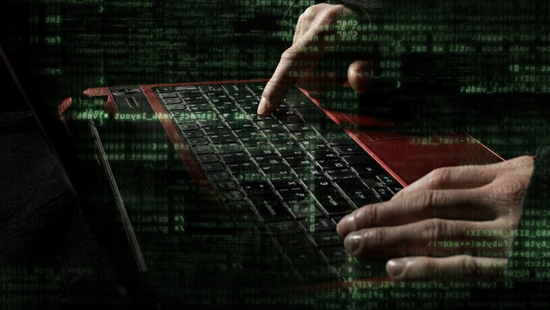 Cyber criminal typing on a keyboard
